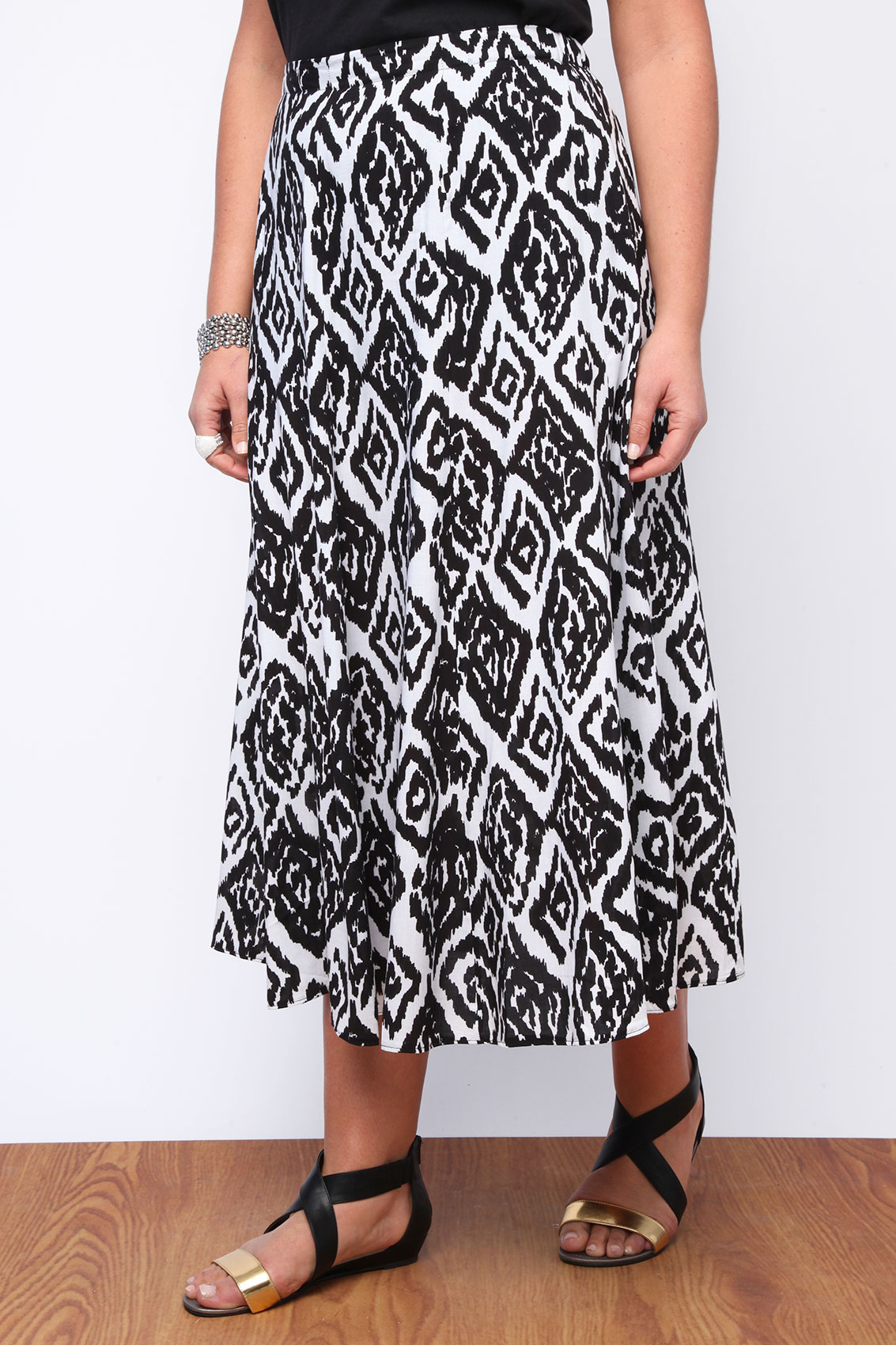Cute and comfy maxi skirt by LulaRoe. 96% polyester, 4% spandex. Machine washable. Black with an aztec tribal print. Size is small. Life is short.
