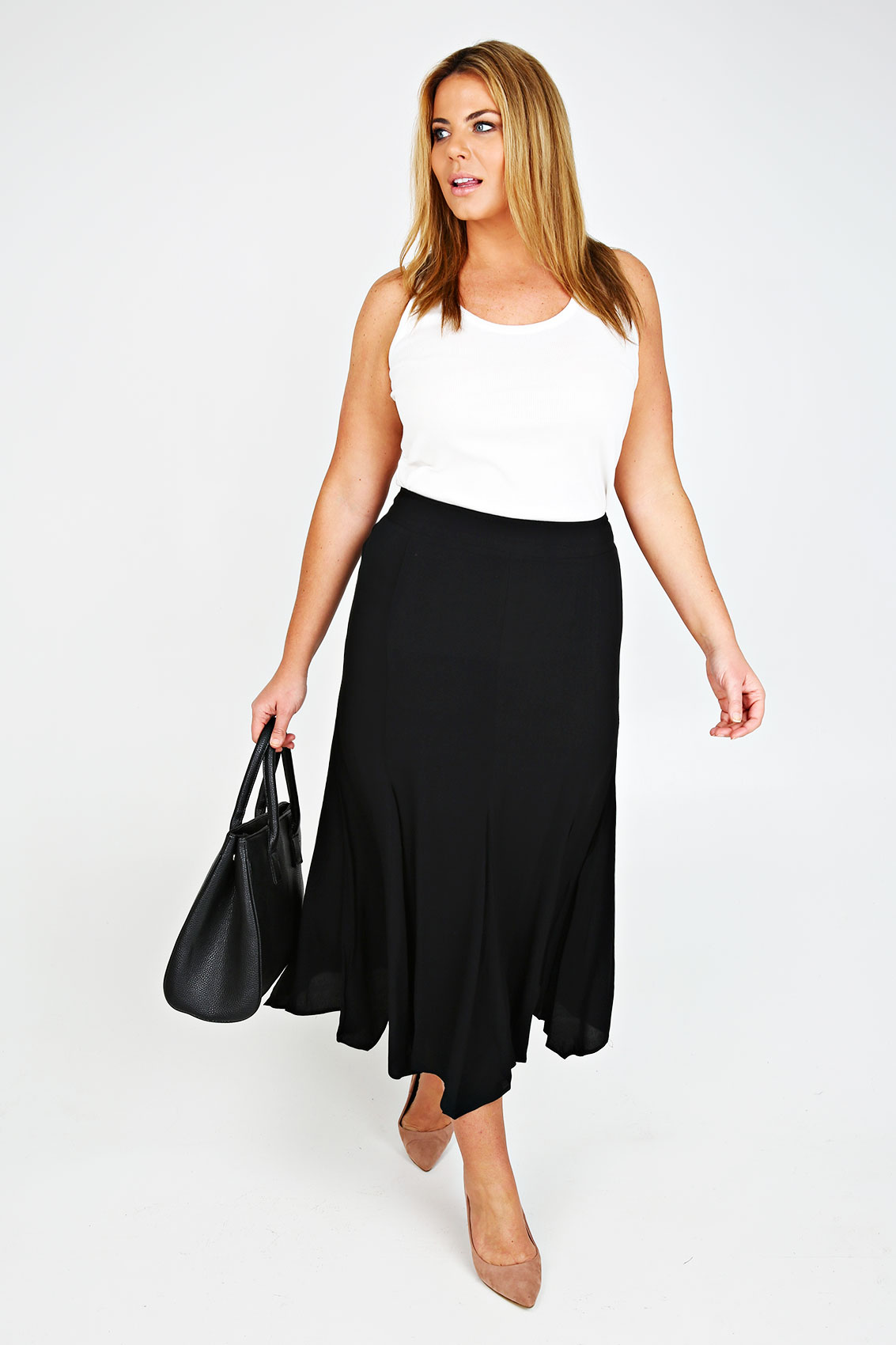 Crinkle Skirt: No iron needed with this carefree crinkle fabric. Skirt features a smooth flat front with an elastic back for comfort. Skirt features a smooth flat front with an elastic back for comfort.